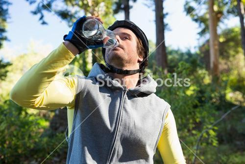 Mountain biker drinking water