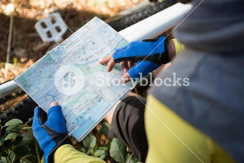 Mountain biker looking at map