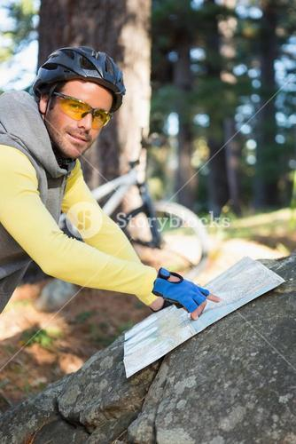 Mountain biker pointing at map