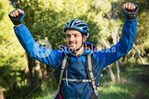 Excited male mountain biker in the forest
