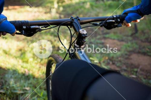 Close-up of male mountain biker riding bicycle