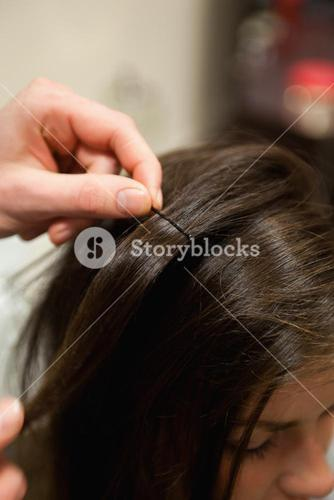 Portrait of a hairdresser putting a hairpin
