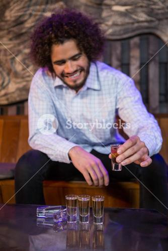 Man having a tequila in bar