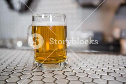 Glass of beer on bar counter
