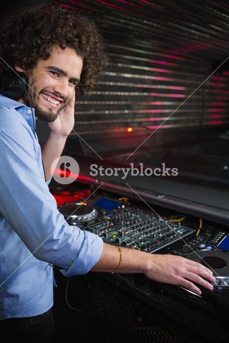 Male DJ playing music