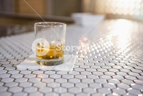 Glass of whisky on bar counter