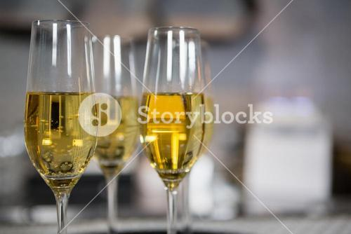 Three glass of champagne on bar counter
