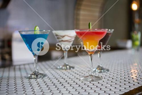 Various cocktails drinks on a bar counter