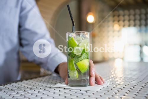 Close-up of man holding glass of gin