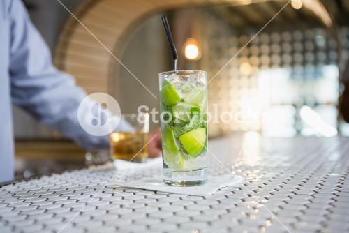 Glass of gin on bar counter