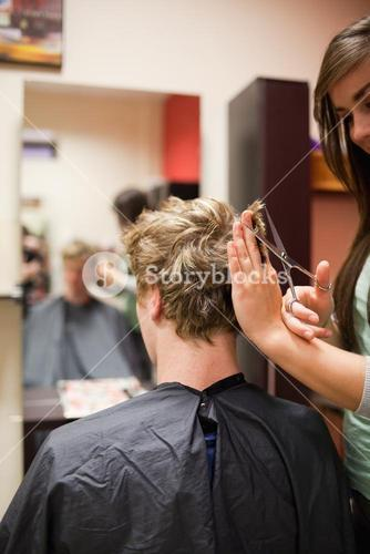 Portrait of a blondhaired man having a haircut
