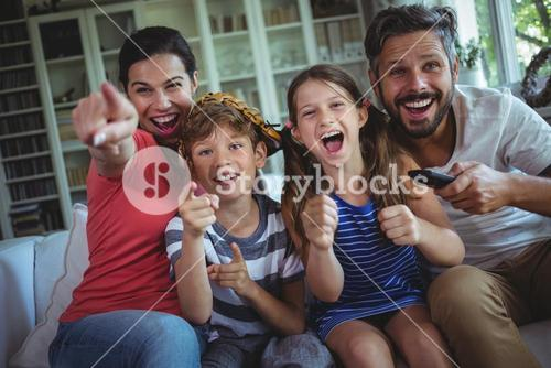 Excited family watching television