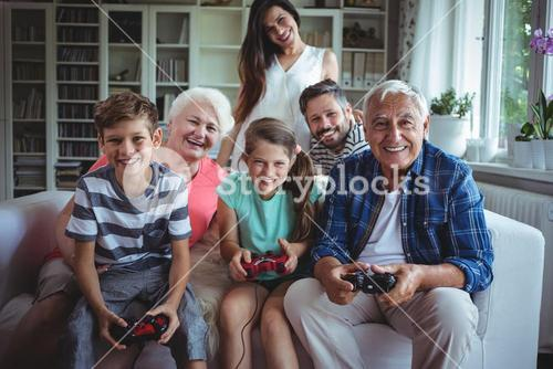 Family watching the kids playing video game