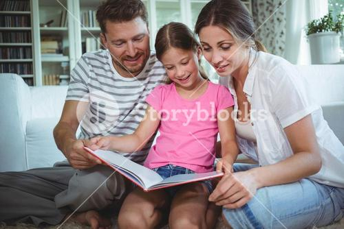 Parents and daughter looking at photo album