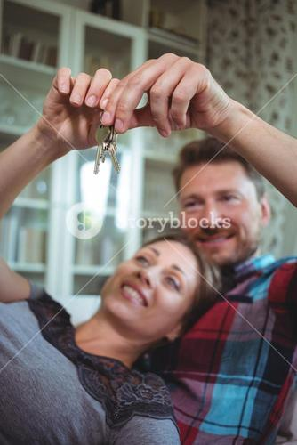 Happy couple holding their house key