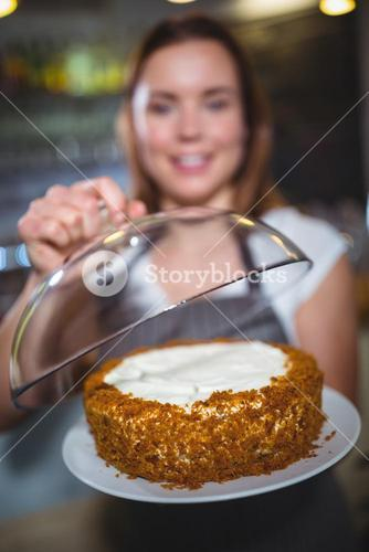 Waitress holding a plate of cake