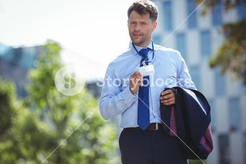 Businessman showing identity card badge