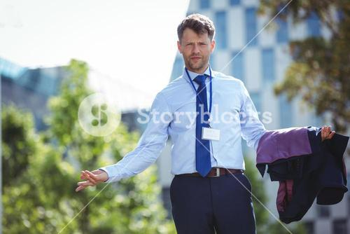 Portrait of handsome businessman standing with blazer