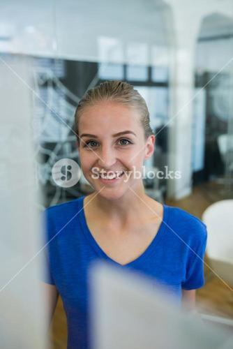 Female executive smiling in office