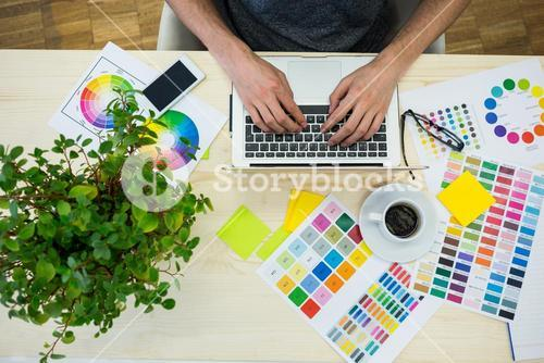 Hands of male graphic designer using laptop