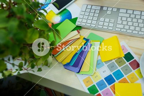 Close-up of parcel tags with sticky notes and keyboard