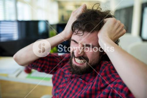 Frustrated male graphic designer in office