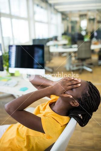 Upset female graphic designer in office