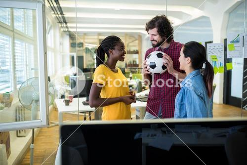 Group of graphic designers interacting with each other