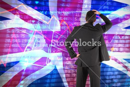 Composite image of businessman standing back to the camera with hand on head
