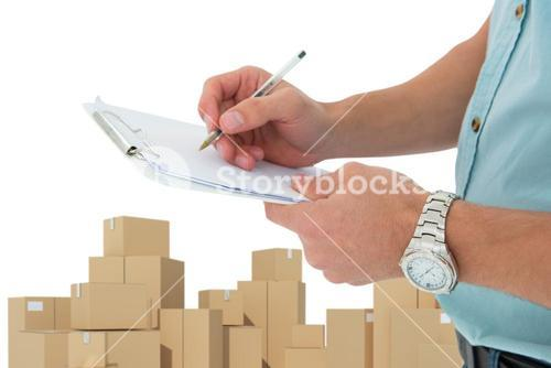 Composite image of delivery man writing on clipboard