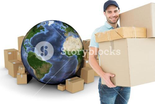 Composite image of happy delivery man carrying cardboard boxes