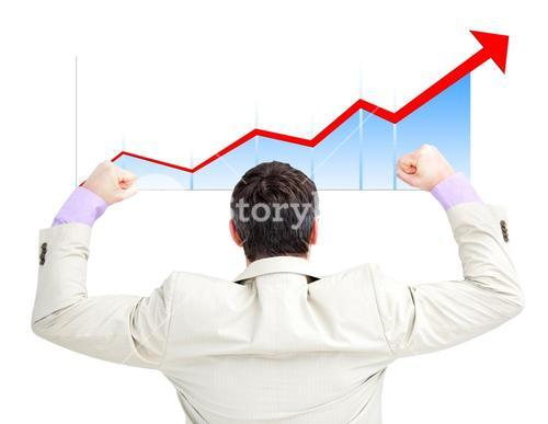 Successful businessman with fists up