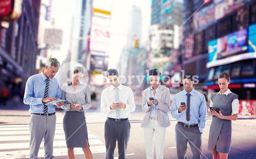Composite image of business people using their phone