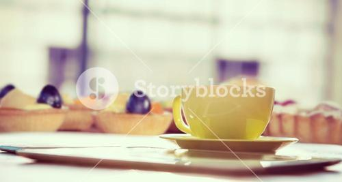 Composite image of cup of coffee and tablet pc