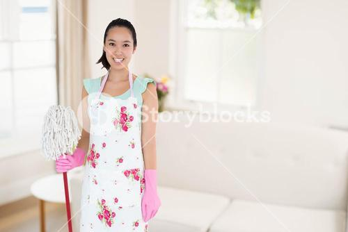 Composite image of happy woman with mop and bucket