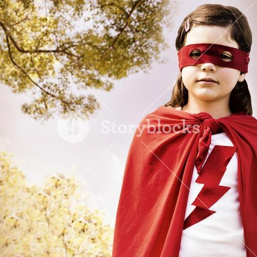 Composite image of portrait of girl in red eye mask and cape
