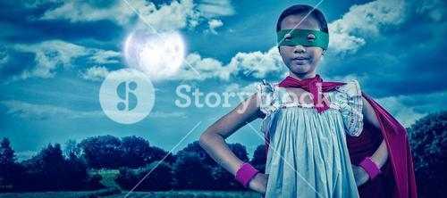 Composite image of girl in cape and eye mask