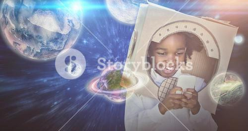 Composite image of boy playing as an astronaut
