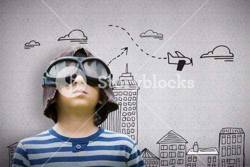 Composite image of boy pretending to be an aviation pilot