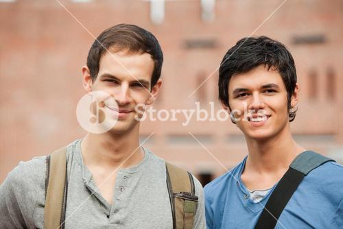 Smiling male students posing