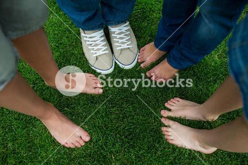 Family standing on grass in park