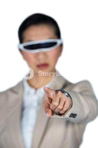 Businesswoman using virtual video glasses