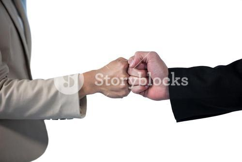 Business people giving fist bump