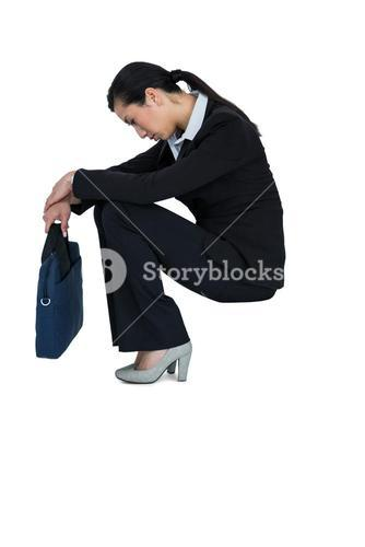 Depressed businesswoman sitting with handbag