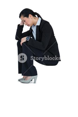 Depressed businesswoman sitting on steps