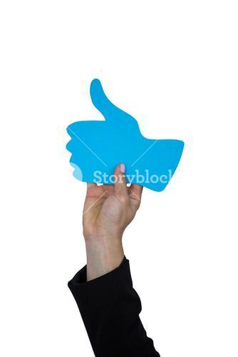 Hand of woman holding thumbs up sign board