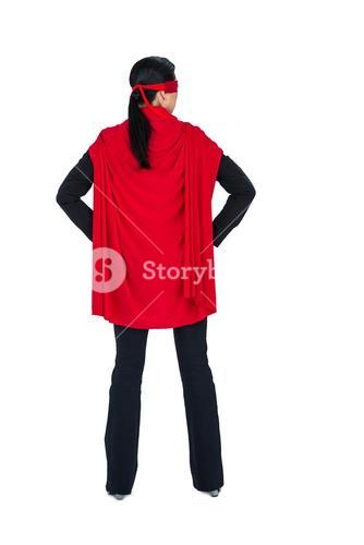 Rear view of woman pretending to be a super hero