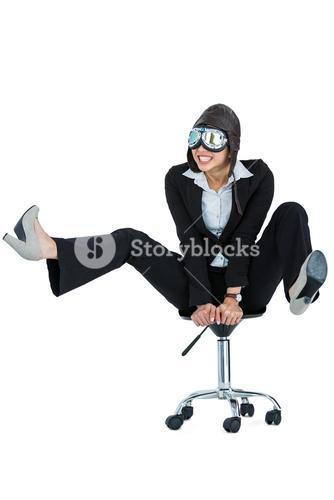 Businesswoman wearing aviator glasses sitting on office chair
