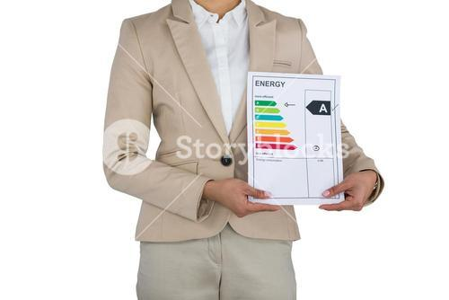 Businesswoman holding graph chart against white background