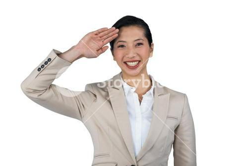 Businesswoman saluting against white background